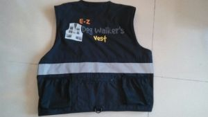 Back of EZ Dog Walker's Vest with safety reflective strips, customized zippered pocket, clip, 2 mesh pockets to carry yours and your dog's water bottle.